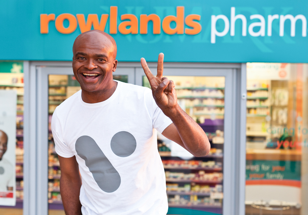 Rowlands Pharmacy store front and V Healthcare ambassador