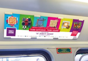 Transport advertisement poster promoting Trinity Square Gateshead
