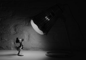 Black and white cartoon Donald duck under spotlight