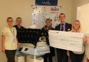 Trinity Square cheque donation for the Tiny Lives Trust