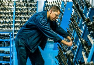 British Engines factory worker surrounded by drill bits