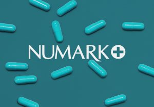 White Numark logo on background with pills